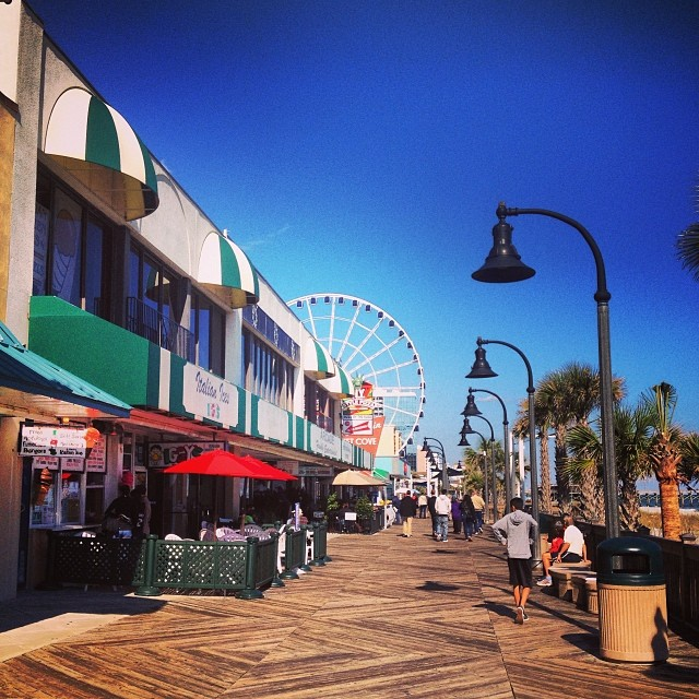 Visitors enjoy the weather in Myrtle Beach and take a stroll on the Boardwalk