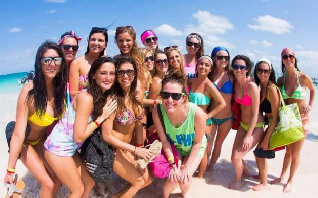 Group of students enjoying a day at the beach during Senior Week