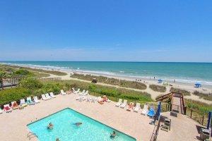 Overlooking the oceanfront pool