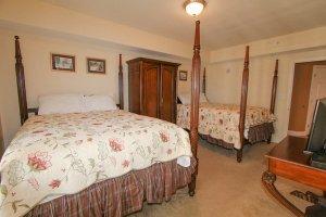 1st guest bedroom with 2 queen beds