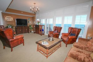 Spacious living area with floor to ceiling ocean views